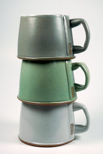 Stack of mugs by Sandy Harquail